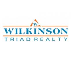 Wilkinson Triad Realty logo